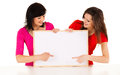 Two young women with whiteboard white background Royalty Free Stock Images