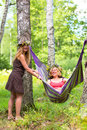 Two young women with wreath and a hammock Royalty Free Stock Photo