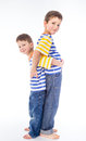 Two younge brother compared growth isolated white Royalty Free Stock Image