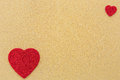 Twos red hearts two on a gold background Royalty Free Stock Photo