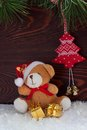 Tоy bear and christmas gifts on a wood background red toy tree Stock Image