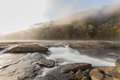 Tygart river cascades over rocks at valley falls state park in fairmont west virginia fog the in the morning sunrise Stock Photography