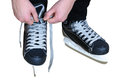 Tying laces on hockey skates shoelaces black isolated white Royalty Free Stock Photo