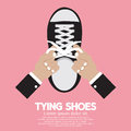 Tying shoes on pink background vector illustration Stock Photo