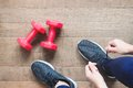 Image : Tying sport shoes, Asian woman getting ready for weight training. Exercise, Fitness training. Healthy lifestyle