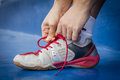Tying sports shoe close up of an athlete their running shoes Stock Photography