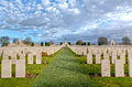 Tyne cot cemetery in flanders fields the remembrance wall for soldiers fallen the great war wwi and headstones of graves at Royalty Free Stock Photo