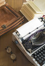 Typewriter and briefcases vintage a blank sheet of paper Stock Photography