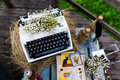 Typewriter old fashioned vintage with flowers Stock Images