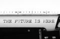 Typewriter. Typing text: the future is here Royalty Free Stock Photo