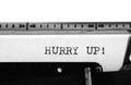 Typewriter typing text hurry up typewriting on an old Stock Photo