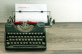 Typewriter with white paper page on wooden table sample text charter Royalty Free Stock Image
