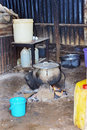 Typical african kitchen cooking food over wood and charcoal fire Royalty Free Stock Photography