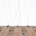 Typical block of flats conected with multiple wires Royalty Free Stock Photo