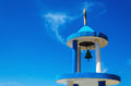 Typical blue white church tower steeple with bell of greek chu against sky Stock Photo