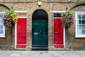 Typical British doors with doorbell in London. Two colorfull doors