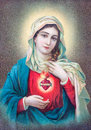 Typical catholic image of heart of virgin mary from slovakia sebechleby july printed in germany the begin cent Royalty Free Stock Images