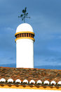 Typical chimney with weathervane Royalty Free Stock Image