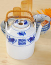 Typical chinese large tea pot with bowls plastic cup and chopstick Royalty Free Stock Photography
