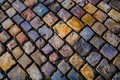 Colorful cobblestone street in european city Royalty Free Stock Photo