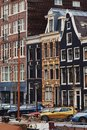 Typical dutch architecture, canals and boats in Amsterdam, Holland, Netherlands