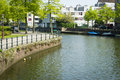 Typical Dutch canal landscape with water, trees,  grass and boat Royalty Free Stock Photo