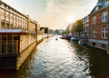 Typical Dutch canal located behind the flower market in Amsterdam. Royalty Free Stock Photo