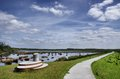 Typical dutch landscape with bicycle path Royalty Free Stock Image