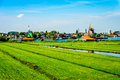Typical Dutch Landscape with open Fields, Canals and Dutch Windmills Royalty Free Stock Photo