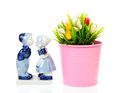 Typical dutch souvenir in delft blue and plastic tulips in bucke bucket over white background Stock Images