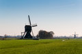 Typical Dutch windmill in backlight Royalty Free Stock Photography