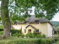 Typical English country thatched cottage. Royalty Free Stock Photo