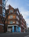 Typical english red brick house with dramatic blue sky in london east end. Royalty Free Stock Photo