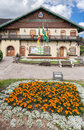 Typical german style building hosting mayor house gramado flags brazil rio grande do sul city yellow blooming flowers garden Royalty Free Stock Photography