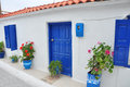 Typical greek house on samos with blue doors and windows Stock Photos