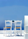 Typical greek terrace with two chairs and table Royalty Free Stock Images