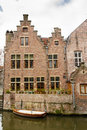 Typical house in gent near a canal with a boat to commute Royalty Free Stock Photos