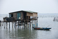 Typical house on the sea lang co hue vietnam with a small houseboat Royalty Free Stock Photography
