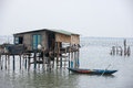 Typical house on the sea lang co hue vietnam with a small houseboat Stock Photo