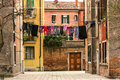 Typical Italian back street scene with washing hanging on line Royalty Free Stock Photo
