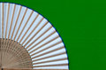 Typical Japanese hand fan made on the wooden green desk