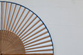 Typical Japanese hand fan made on the wooden white desk