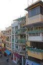Typical linked shophouses in macau multi storey around ruins of st paul Royalty Free Stock Photo