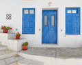 Typical mediterranean island house facade blue white and flowerpots Stock Photography