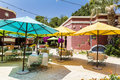 Typical mexican restaurant with colorful umbrellas and bougainvillea trees Royalty Free Stock Photo