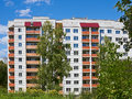 Typical modern residential building in the park area in summer time Royalty Free Stock Photo