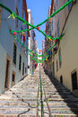 Typical narrow stepped street of lisbon portugal decorated due to local festivities Royalty Free Stock Photos