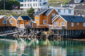 Typical Norwegian fishing village with traditional red rorbu hut Royalty Free Stock Photo