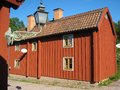 Typical old wooden red house linkoping sweden a picturesque corner in gamla friluftsmuseet open air museum all buildings in the Royalty Free Stock Photo