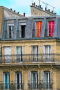 Typical parisian residential building vertical oriented image of with balconies and mansards in paris france Stock Photo